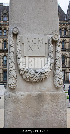Detail of one of the obelisks flanking central cenotaph of Manchester England war memorial showing garland of leaves and inscription MCMXIV - Stock Photo