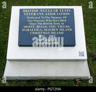 Plaque at foot of cenotaph of Manchester England war memorial reads British Nuclear Tests Veterans Association dedicated to test veterans - Stock Photo