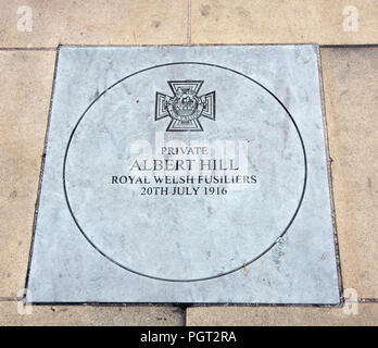 Plaque at foot of Manchester England war memorial showing Victoria Cross awarded Private Albert Hill Royal Welsh Fusiliers 20th July 1916 - Stock Photo