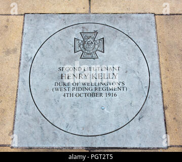 Plaque at foot of Manchester England war memorial showing Victoria Cross awarded Second Lieutenant Henry Kelly Duke of Wellington's (West Riding Regim - Stock Photo