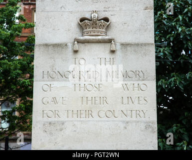 Central cenotaph Manchester war memorial showing crown and inscription reading TO THE HONOURED MEMORY OF THOSE WHO GAVE THEIR LIVES FOR THEIR COUNTRY - Stock Photo