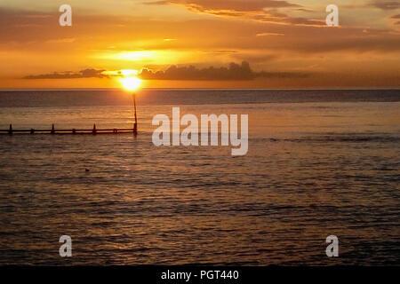 Sun set South beach Aberaeron West Wales UK - Stock Photo
