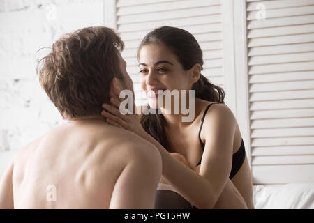 Excited girlfriend looking at boyfriend happy to make peace - Stock Photo