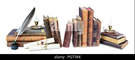 Composition of old books, candle in candlestick, feather in inkpot and scroll with stamp, isolated on black background - Stock Photo