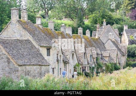 Cotswold stone cottages, Arlington Row, Bibury, Gloucestershire, England, United Kingdom - Stock Photo