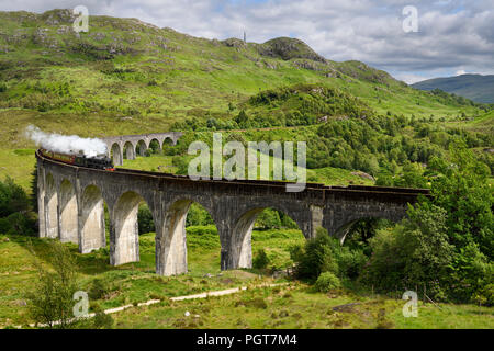 Heritage Jacobite coal fired Steam Train at Glenfinnan viaduct in the Lochaber Scottish Highlands Scotland United Kingdom - Stock Photo