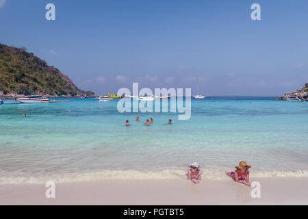 Editorial: March, 10, 2016, Raya Island Beach, Thailand with tourists swimming and laying on the shore in the sand. - Stock Photo