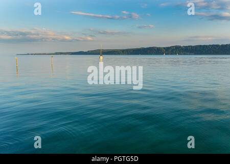 Germany, Many sail boats on lake constance in dawning light - Stock Photo