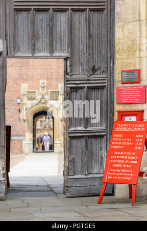 Notice board by the main entrance to St John's college, university of Cambridge, England, informing of admission charges. - Stock Photo