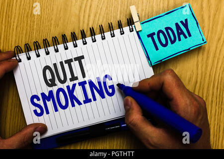 Conceptual hand writing showing Quit Smoking. Business photo showcasing Discontinuing or stopping the use of tobacco addiction Man holding marker expr - Stock Photo