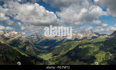 View of the alpine town of Zug, in the Zug Valley in the Vorarlberg region of Austria from the top of the Rufikopf mountain - Stock Photo