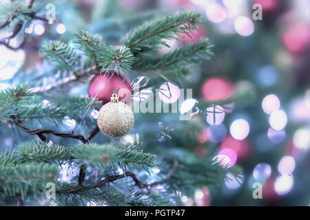 Christmas spurse tree with decorations, christmas balls, silver garlands, bokeh. Light festive background. Selective focus. Winter holiday, Happy New Year, xmas. - Stock Photo