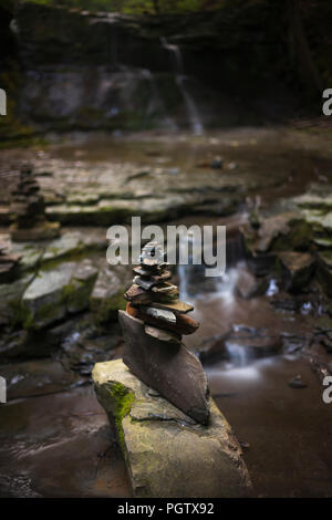 Cairns found in a creek at the IBM Glen in Endwell, NY. - Stock Photo