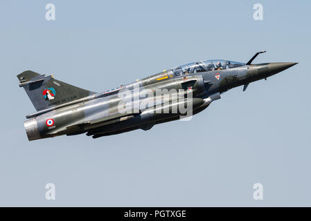A Dassault Mirage 2000D fighter jet of the French Air Force is taking off from the Nancy-Ochey Air Base. - Stock Photo