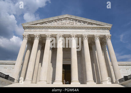 The U.S. Supreme Court building in Washington, D.C., on a sunny afternoon in August. - Stock Photo