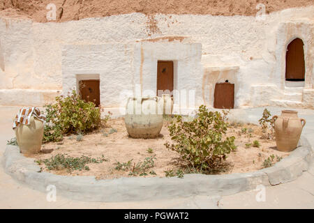 Courtyard of berber underground dwellings, Matmata, Tunisa - Stock Photo