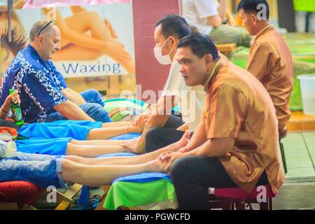 Bangkok, Thailand - March 2, 2017:  Foot massage service in spa salon at Khao San Road night market, Bangkok, Thailand. - Stock Photo