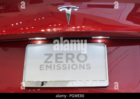 AUCKLAND - AUG 28 2018:The insignia of Tesla on the fback bonnet of the plug-in electric car Model 3, a mid-size / compact executive luxury four-door  - Stock Photo