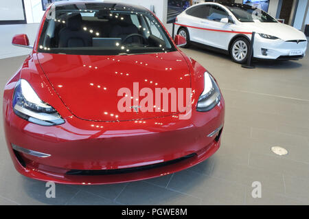 AUCKLAND - AUG 28 2018:The insignia of Tesla on the front bonnet of the plug-in electric car Model 3, a mid-size / compact executive luxury four-door  - Stock Photo