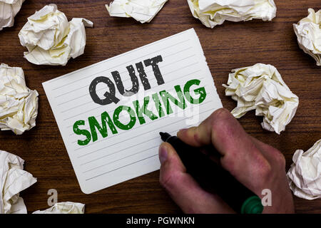 Conceptual hand writing showing Quit Smoking. Business photo showcasing Discontinuing or stopping the use of tobacco addiction Man holding marker note - Stock Photo