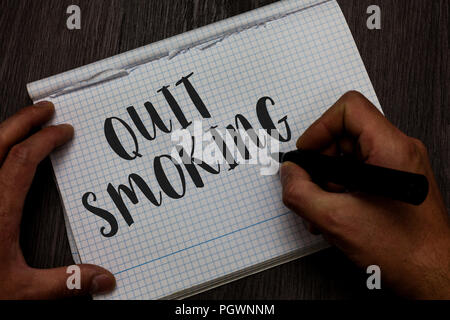 Writing note showing Quit Smoking. Business photo showcasing Discontinuing or stopping the use of tobacco addiction Man hand holding marker communicat - Stock Photo