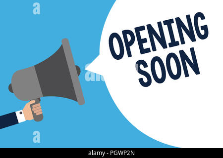 Handwriting text writing Opening Soon. Concept meaning Going to be available or accessible in public anytime shortly Man holding megaphone loudspeaker - Stock Photo