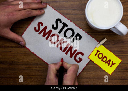 Conceptual hand writing showing Stop Smoking. Business photo text Discontinuing or stopping the use of tobacco addiction Man holding marker notebook r - Stock Photo