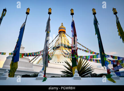 Bodnath Buddhist Stupa with prayer flags in Kathmandu - Stock Photo