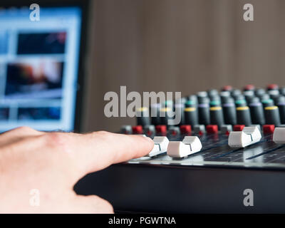 Man producing music in audio studio indoors - Stock Photo
