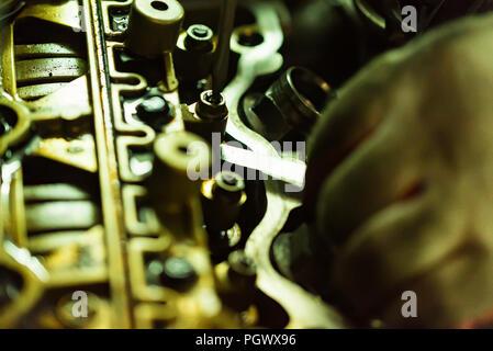 Maintenance check and adjust valve lash in car engine Stock