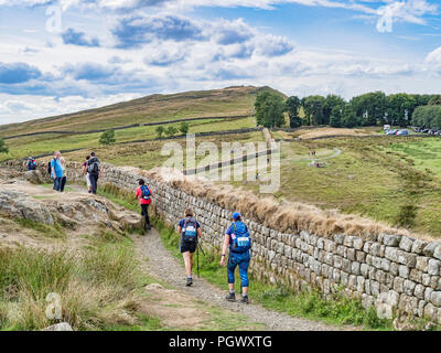 11 August 2018: Northumberland UK - Participants in Trek26, on behalf of the Alzheimer's Society, on the Hadrian's Wall footpath, Northumberland, UK - Stock Photo