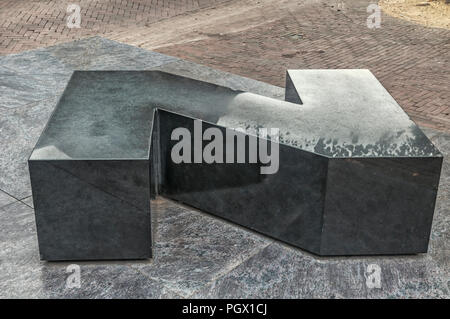 large granite letter N placed on the street - Stock Photo