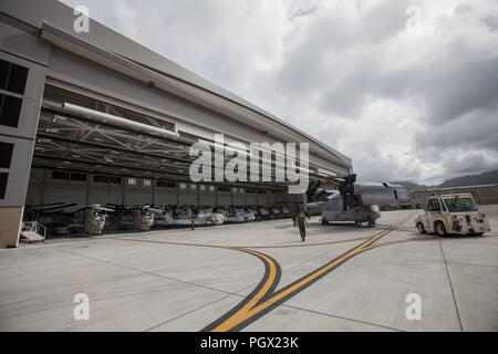 U.S. Marines parking an MV-22 Osprey aircraft among other secured aircraft and vehicles prior to Hurricane Lane's arrival at Marine Corps Air Station (MCAS) Kaneohe Bay, Hawaii, August 22, 2018. Image courtesy Sgt. Jesus Sepulveda Torres / Marine Corps Base Hawaii. () - Stock Photo