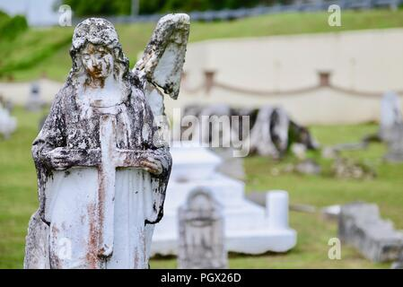Angel statue in Sumay Cemetery, Guam, July 19, 2018. Image courtesy Petty Officer 3rd Class Amanda Levasseur / U.S. Coast Guard District 14 Hawaii Pacific. () - Stock Photo