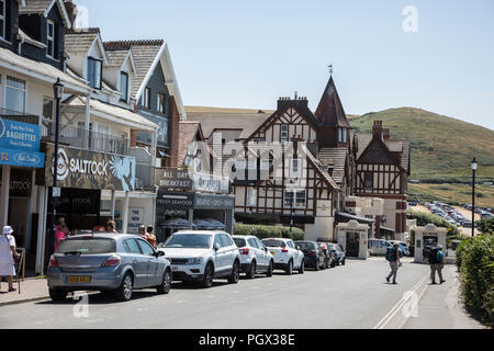 Woolacombe shop fronts and hotel near the beach front on a bright sunny day in the summertime in Woolacombe, North devon, England - Stock Photo