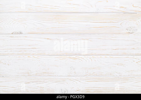 White plank texture of old wood table. Rustic aged wooden background. - Stock Photo