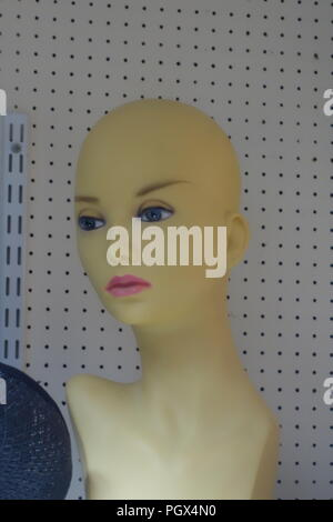 Female Mannequin Head with no hair on display an English Antiques and Bric-à-brac centre - Stock Photo