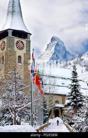 Pfarrkirche St. Mauritius Catholic Church below the looming Matterhorn, Zermatt, Valais, Switzerland - Stock Photo