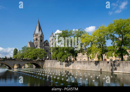 Temple neuf and modern artwork Voyage on the Moselle river during Festival Constellations in the city Metz, Moselle, Lorraine, France - Stock Photo