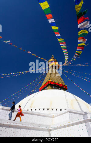 Bodhnath , Kathmandu, Bagmati, Nepal : People walk around the Great stupa of Bodhnath, the largest in Asia and one of the larger in the world. - Stock Photo