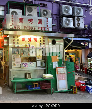 This food stall in Central District is known for serving well made coffee and tea, together with delectable local dishes - Stock Photo
