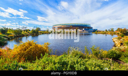Optus Stadium surrounded by a lake and parkland. Perth, Western Australia - Stock Photo