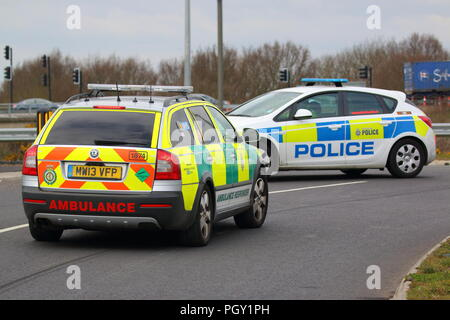 Emergency service vehicles at the scene of a Road Traffic Accident on the Great Yorkshire Way in Doncaster, South Yorkshire. - Stock Photo
