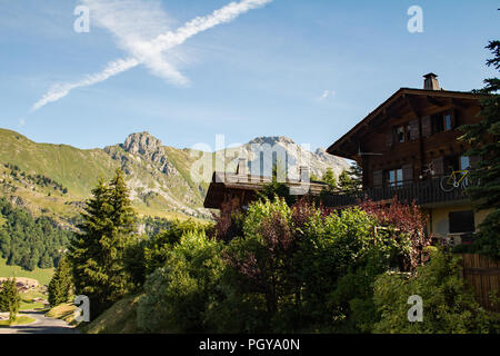 Vapour trail in the mountain air over Jalouvre, Le Chinaillon, Le Grand Bornand,  Haute Savoie. - Stock Photo