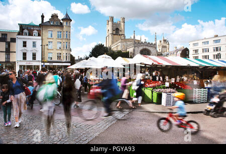 Cambridge Market on a busy saturday in Summer.Tourists and locals alike visit the market and are blurred through a long exposure - Stock Photo