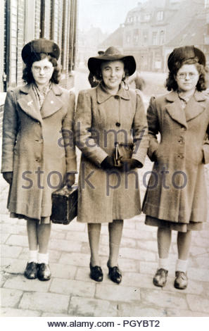 mother with two daughters standing 1940s Holland - Stock Photo