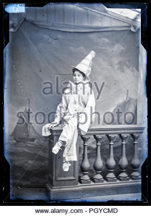 studio portrait of a young adult woman dressed up in mime artist clothing France, circa 1920s - Stock Photo