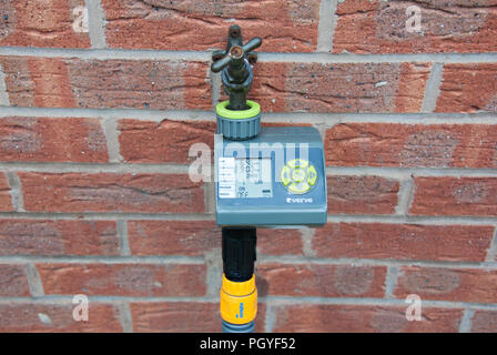 verve programmable water timer fixed to a brick wall - Stock Photo