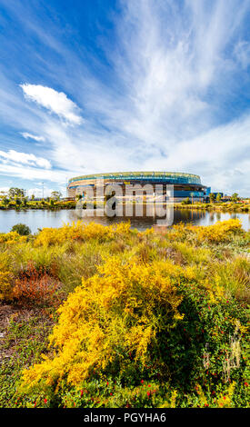 Optus Stadium and Stadium Park with native plants growing beside a lake