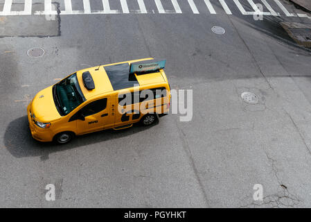 New York City, USA - June 22, 2018: Yellow taxi cab in Manhattan. High angle view. Nissan NV200 is the model of the New York City taxi - Stock Photo